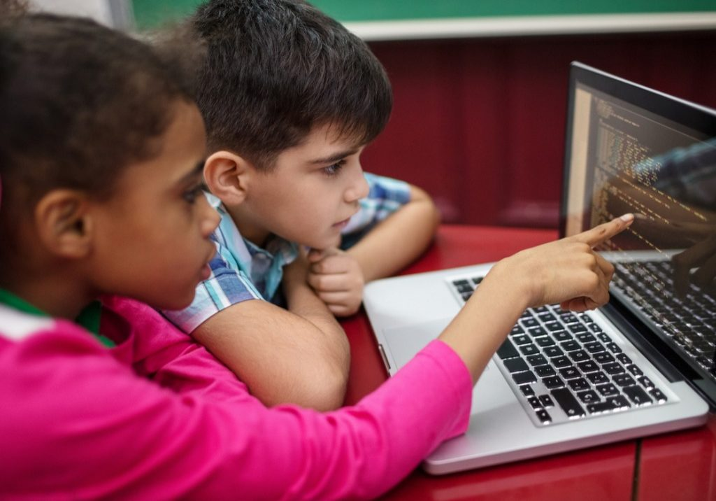students-creating-programs-while-using-laptop-picture-id996990848